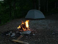 Picture of the tent set up at night with camp fire alight